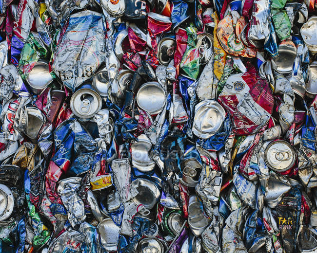 Mass of aluminium cans processed at recycling plant, full frame. — Stock Photo