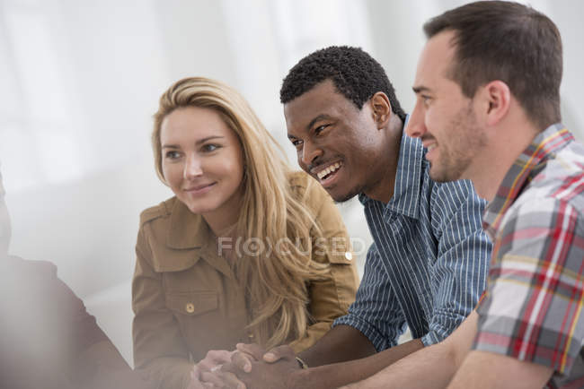 Small group of people talking while meeting in office. — Stock Photo