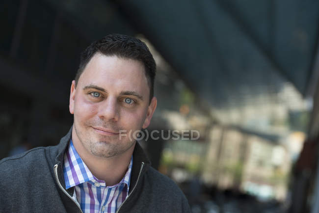Portrait of mid adult man in a open-necked shirt and jacket. — Stock Photo