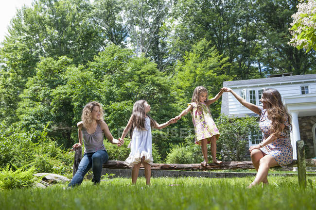 Family playing in green garden in summer. — Stock Photo