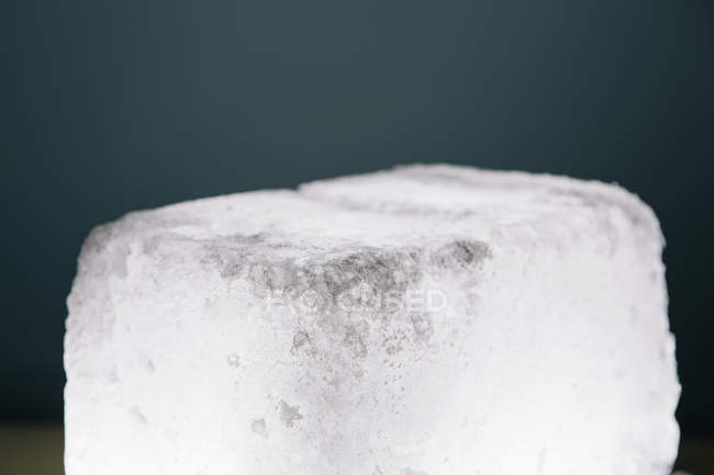 Detail of ice cube on gray background, close-up. — Stock Photo