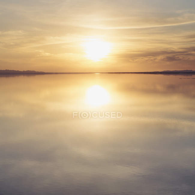 Shallow water over surface at Bonneville Salt Flats near Wendover at dusk, USA. — Stock Photo