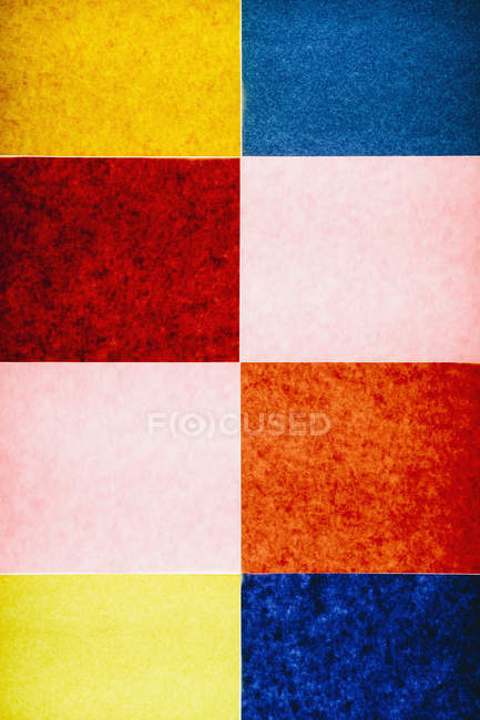 Multicolored pattern of rectangles of recycled construction paper. — Stock Photo