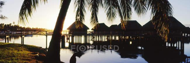 Scenery over water huts at tropical resort, Tahiti — Stock Photo