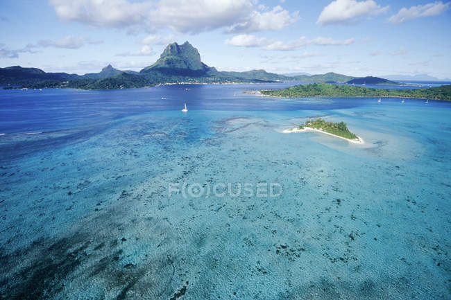 Aerial view of blue lagoon water in Bora Bora — стоковое фото