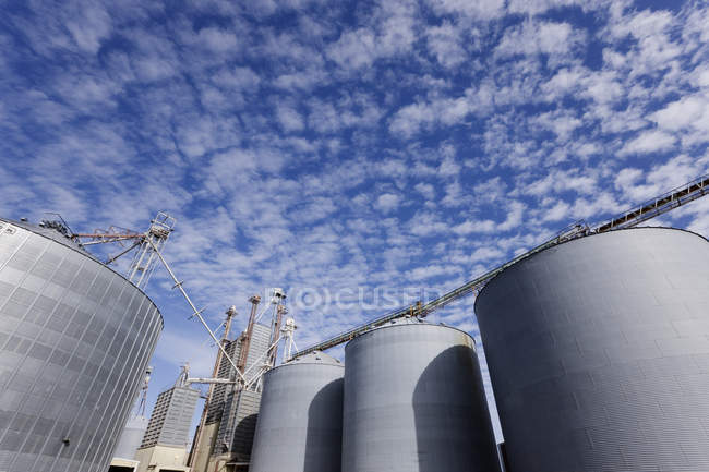 Silos against blue sky with clouds in Texas, USA — Stock Photo