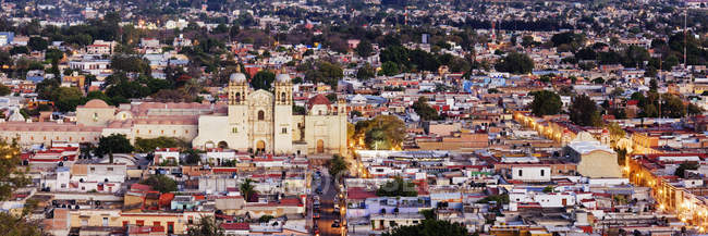 Cityscape of Oaxaca town with houses and church in Mexico — стокове фото