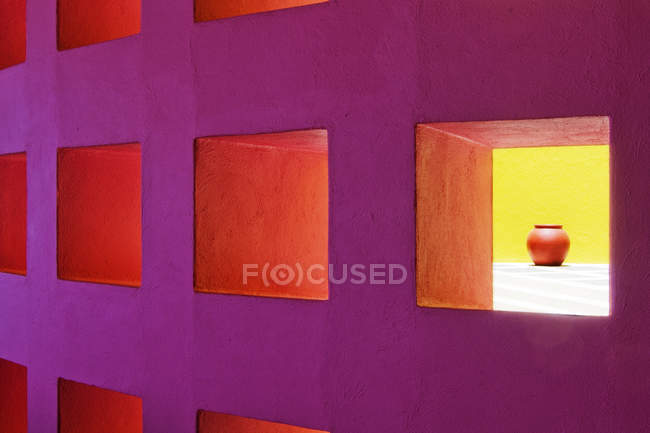 Niches in purple modern wall with illumination, full frame — Stock Photo