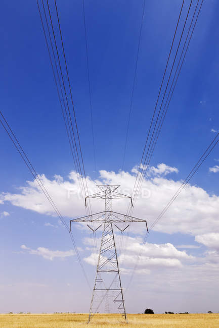 Power pylon on country plains under clouds in Texas, USA — Stock Photo