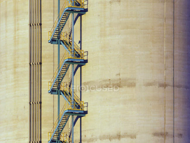Metal ladder on side of industrial building — Stock Photo