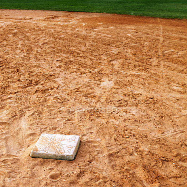 Base on baseball field with footprints, close-up — Stock Photo