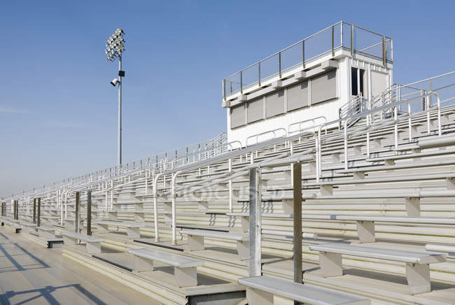 Railings and bleachers at high school stadium — Foto stock