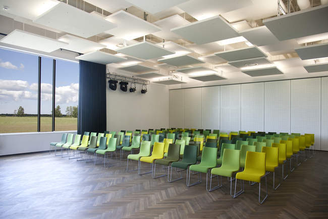 Green chairs in presentation room interior — Stock Photo