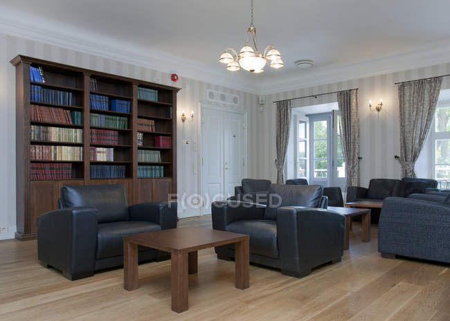 Upscale reading room with cozy armchairs — Stock Photo