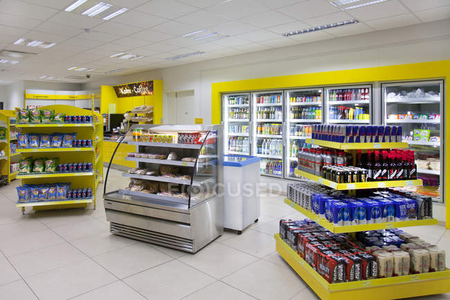 Convenience store with various goods at gas station  in Estonia — Stock Photo
