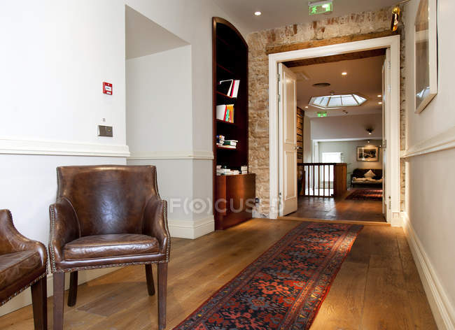 Armchairs and bookcase in hallway, Pdaste Manor interior, Estonia — Stock Photo