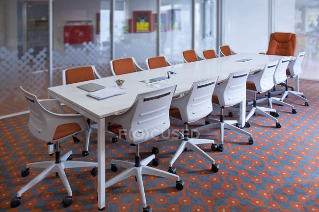 Empty conference room with long table and chairs — Stock Photo