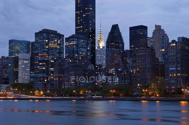 New York City skyline across water, New York, USA — Stock Photo
