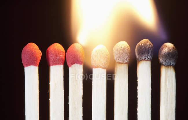Close-up of burning matches against dark background — Stock Photo
