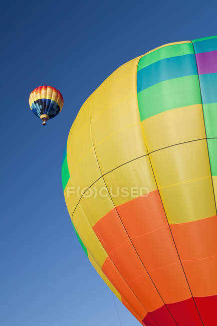 Hot air balloons in flight against blue sky — Stock Photo
