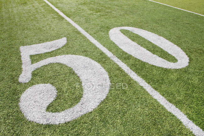 50 yard line on American football field grass — Stock Photo