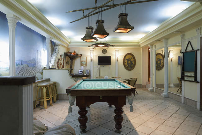 Billiards table in leisure lounge interior — Stock Photo