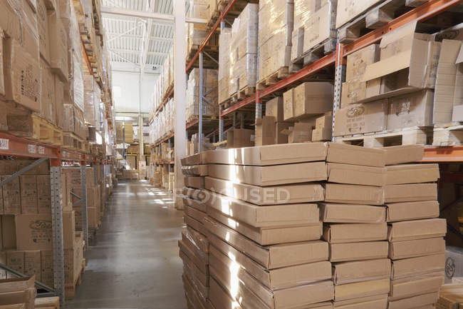 Cardboard boxes on shelves in warehouse, Moscow, Russia — Stock Photo