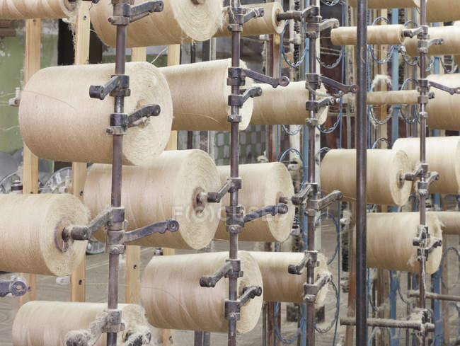 Spools of threads in textile factory, Nikologory, Russia — Stock Photo