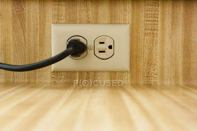 Wall socket with power cable in California, USA — Stock Photo