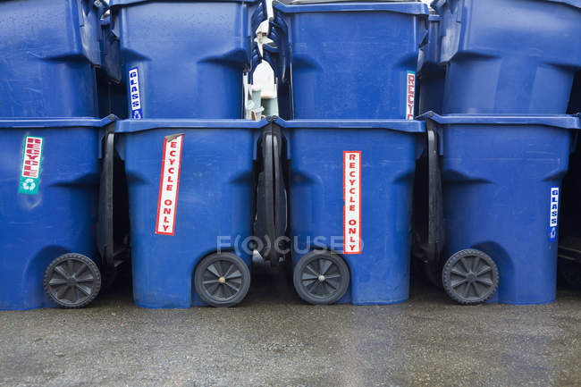 Blue recycle bins stacked in Seattle, Washington, USA — стокове фото