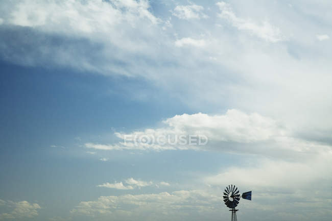 Windmill against blue sky with white clouds — Stock Photo