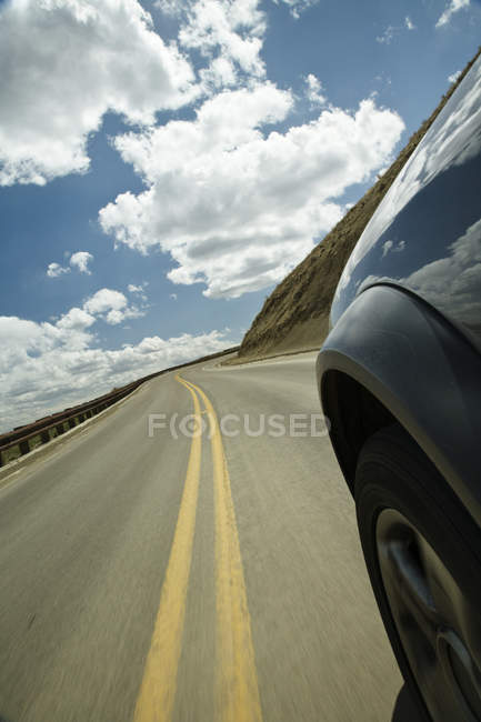 Close-up of car wheel riding on roadway — Foto stock