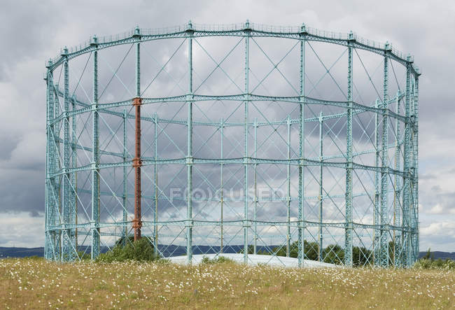 Unused gasworks structure in country field, Ross-Shire, Scotland, UK — Stock Photo