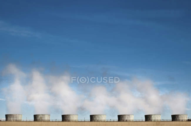 Pollution emitting from cooling towers in California, USA — Stock Photo