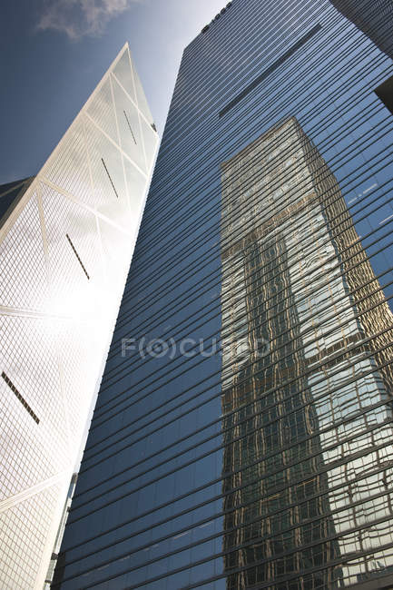 Skyscrapers reflection in downtown of Hong Kong in low angle view, China — Stock Photo