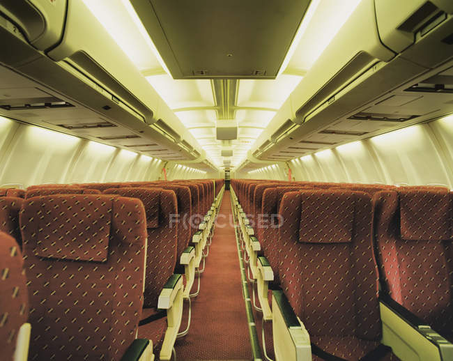 Empty airplane with rows of seats — Stock Photo