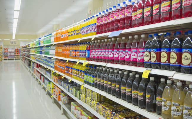 Bottled juice on supermarket shelves in England, Great Britain, Europe — Stock Photo