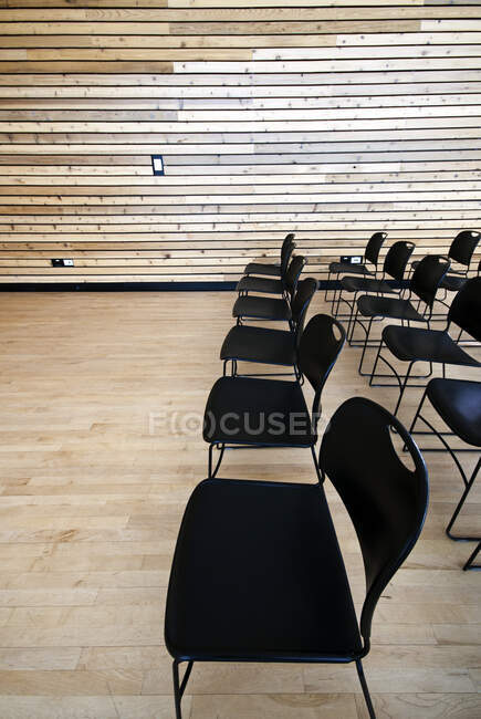 High angle view of empty black chairs in auditorium — Stock Photo