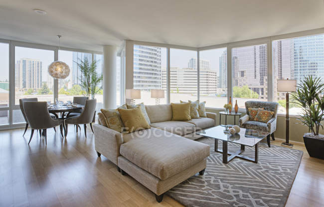 Living room and dining room in luxury highrise apartment — Photo de stock