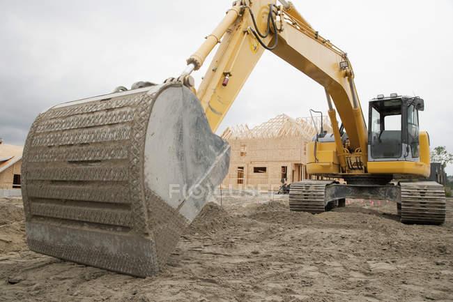 Bulldozer breaking ground at construction site — Stock Photo