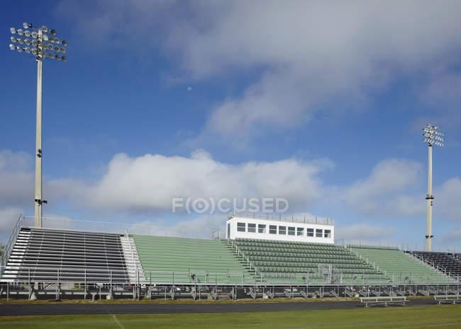 Bleachers at high school sports field — Foto stock