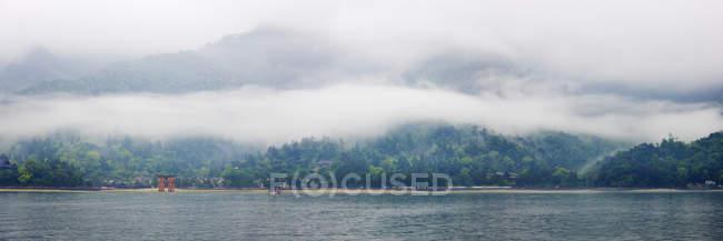 Panoramic view of landscape across lake in Miyajima Island, Japan — Stock Photo