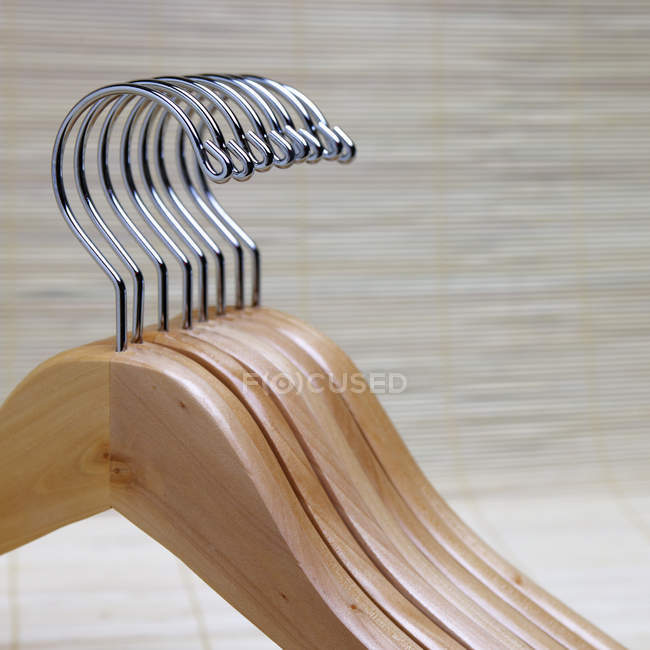 Wooden clothes hangers stacked in row — Stock Photo