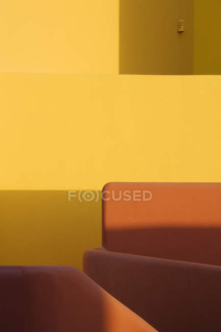 Shadows on walls and furniture in orange and yellow — Stock Photo