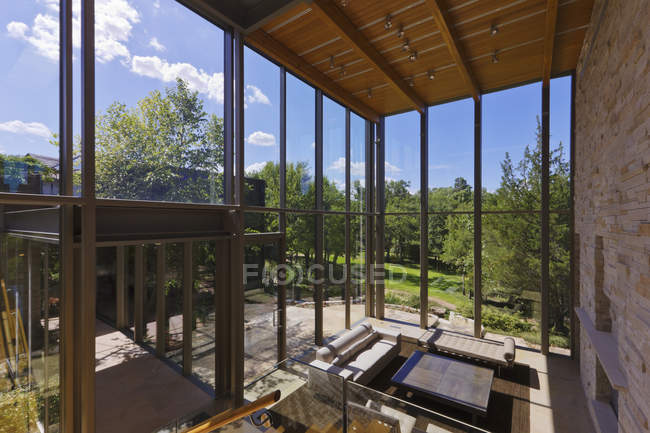 Spacious living room with scenery of woods — Stock Photo