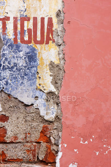 Weathered and cracked wall with lettering — Stock Photo