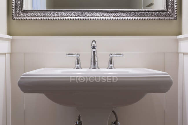 Faucet and sink in modern bathroom — Stock Photo
