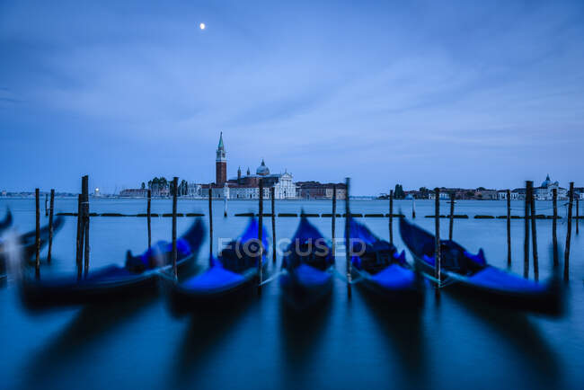 Blue gondolas at night in Venice, Italy — Stock Photo