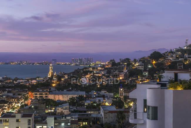 Aerial view of illuminated cityscape and skyline at dusk, Puerto Vallarta, Mexico — стокове фото