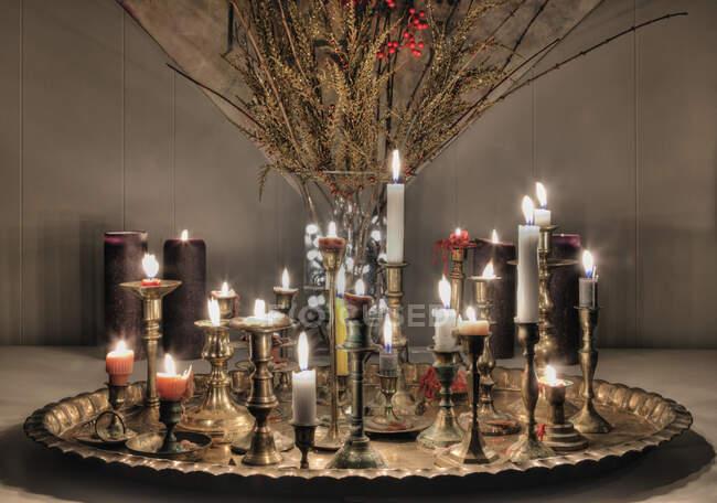 Candles burning on metal platter — Stock Photo
